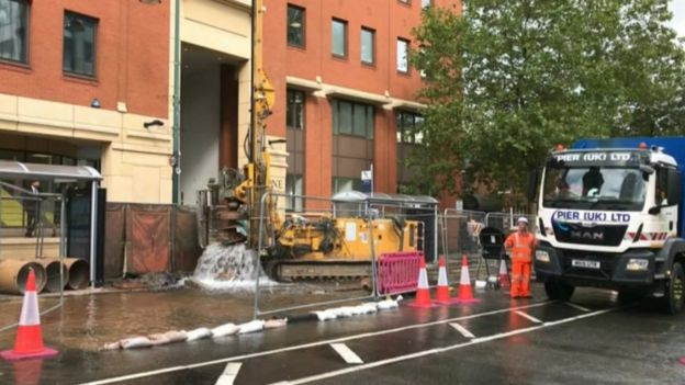 Street floods after workers damage pipe
